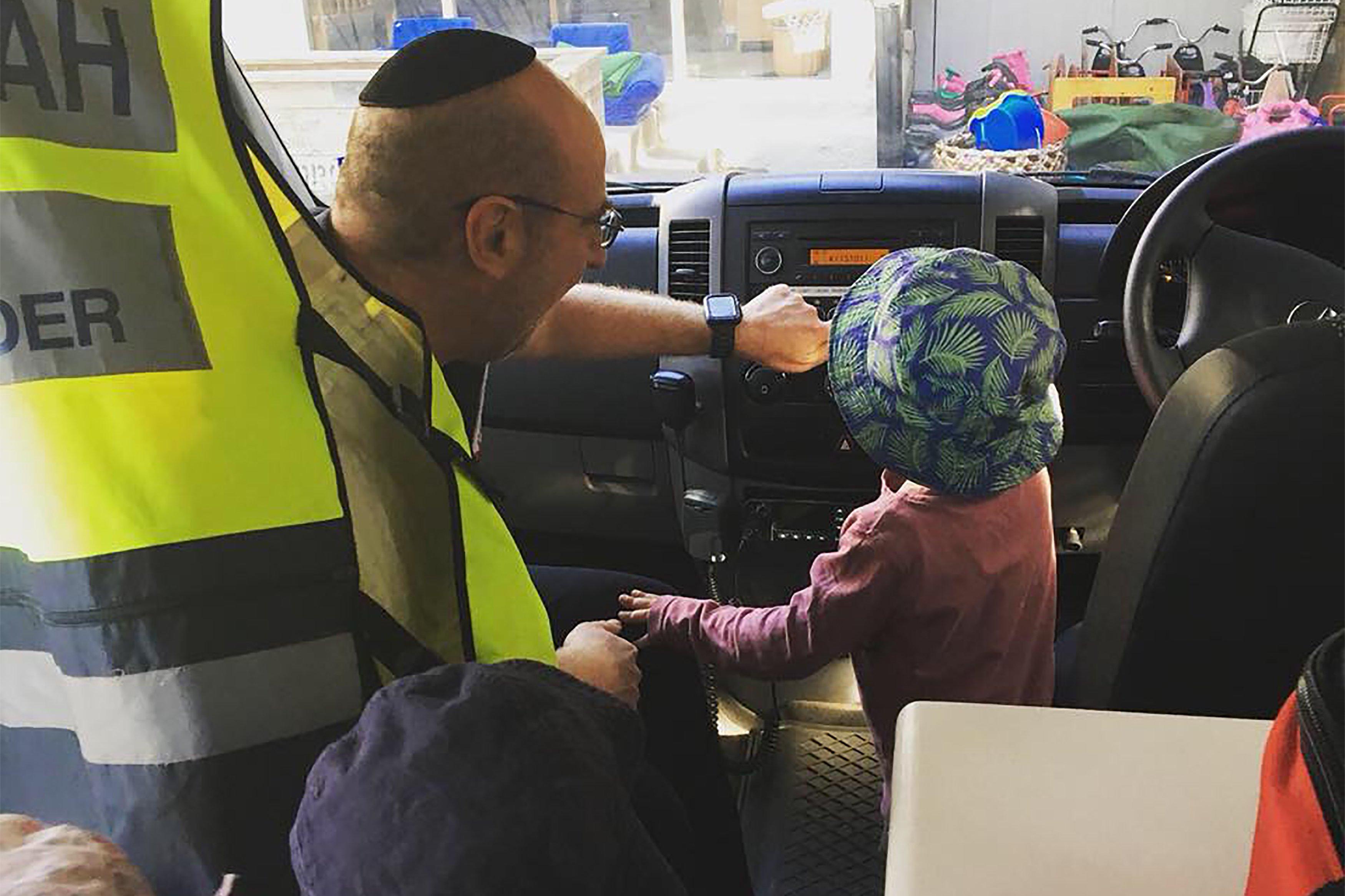 Hatzolah Melbourne Responder Leon Landau at a childcare with community ambulance