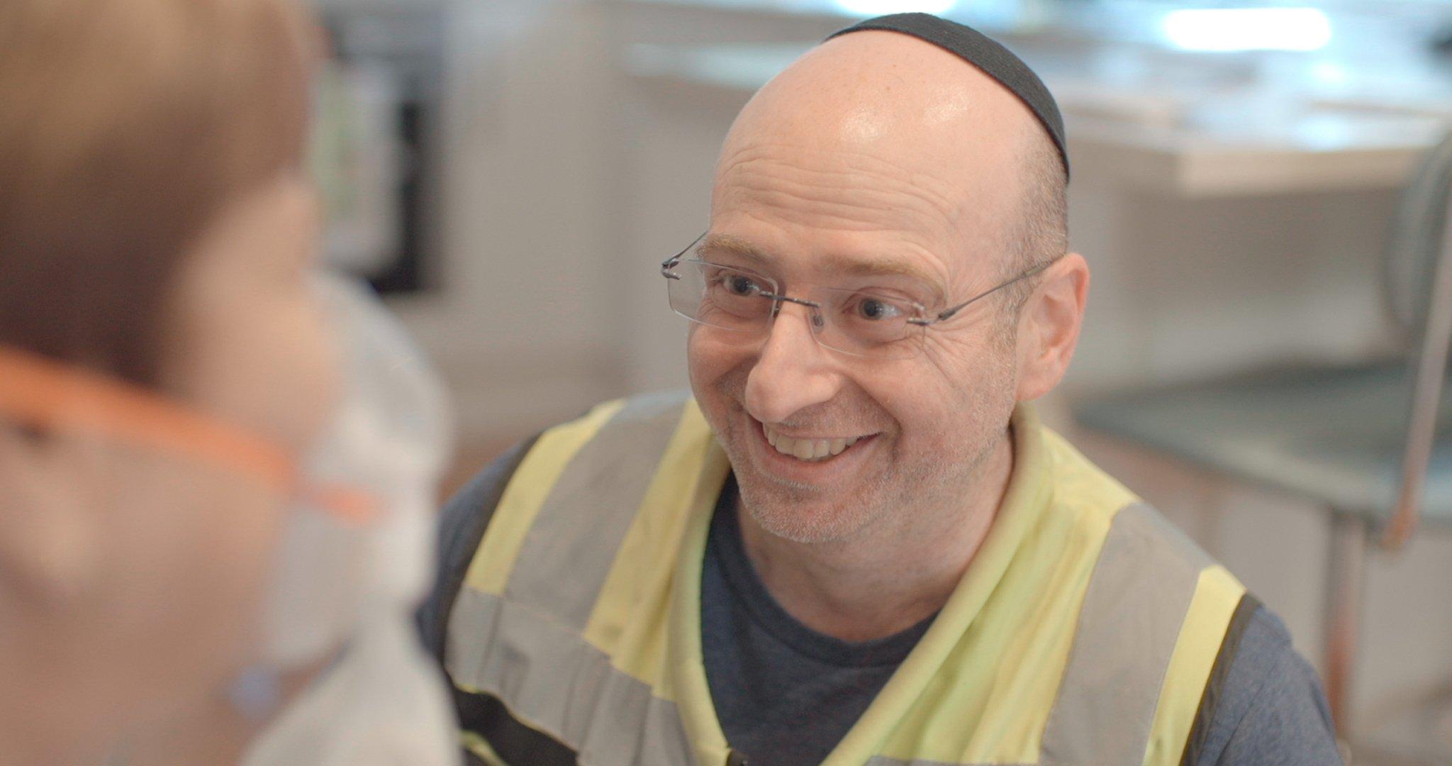 Hatzolah Melbourne Responder Leon Landau treating a patient